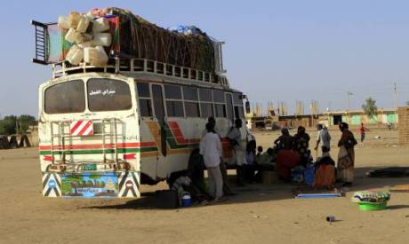 Souther Sudanese wait for a bus