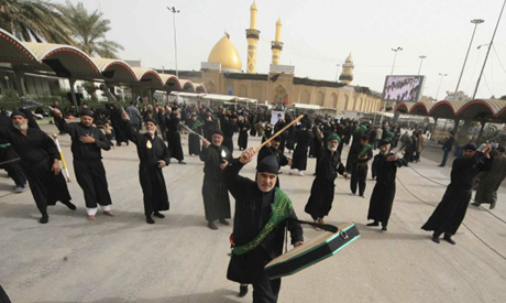 Shia pilgrims beat themselves with iron chains as they take part in the preparation of Ashura ceremo