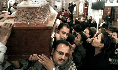 The coffin of a 71-year-old Christian man