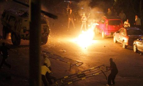 Clashes between protesters and military police outside Maspero (Photo by: AP)