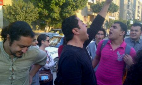 Bahaa Saber leading chants against military trials after being released (photo by: Mona Seif)