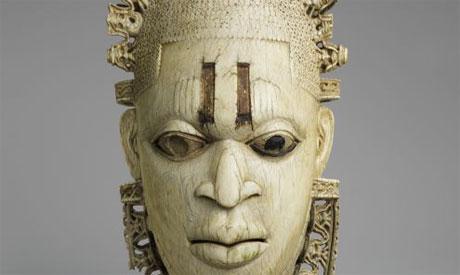 Queen mother pendant mask. Nigeria, 16th century. Ivory, iron, copper (?). (Courtesy: Metropolitan m