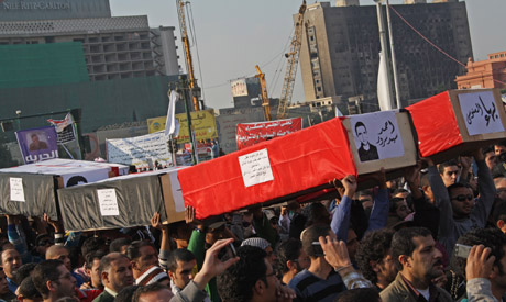 Hundreds of protesters take part in funeral march