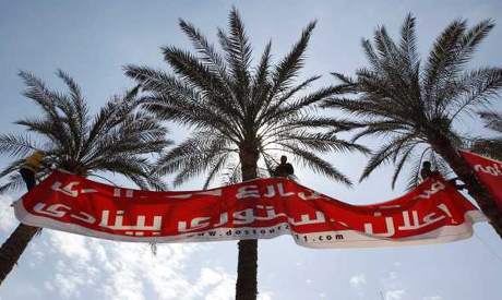 Men put up banner to protest against referendum planned for March 19 during rally in Cairo