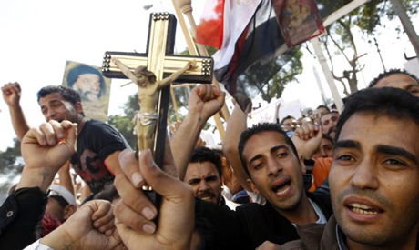 People demonstrate in front of the Egyptian Television building to protest the torching of a church
