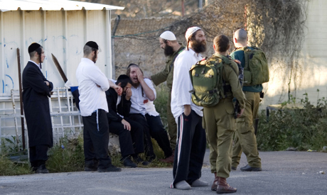 Israeli settlers moments after they arrived at an entrance to a military base near the West Bank cit