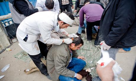 Getting medical treatment in Tahrir Square – Photo by Hossam El Hamalawy