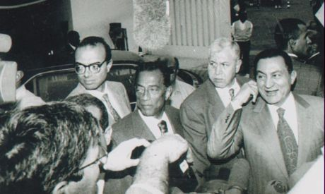An old picture in which Husain Salem appears with the then president Mubarak