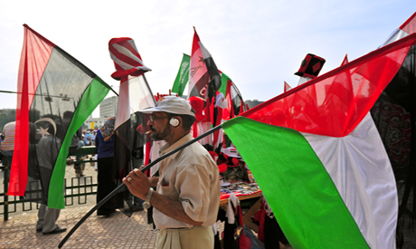 A flag vendor in Tahrir Square – Photo by Mohamed El Hebeishy