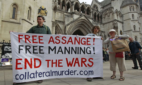 Supporters of Julian Assange protest outside the High Court in London (AP Photo)