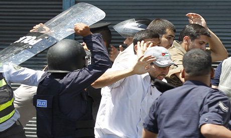 Police beat journalists who were covering demonstration in Amman [AFP]