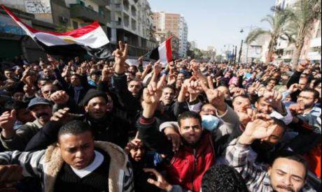 Protestors march in Suez