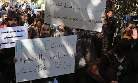 Syrians protesters opposed to Syrian President Bashar Assad regime during a gathering outside the Sy