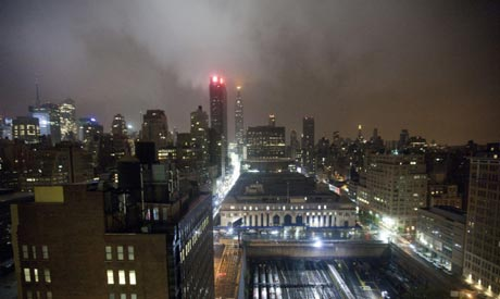 The New York City skyline is seen under clouds as Hurricane Irene approaches the region