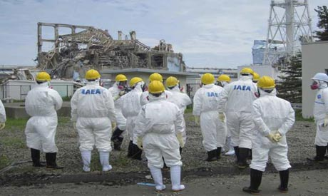 File picture of International Atomic Energy Agency (IAEA) inspection team members in Fukushima Prefe