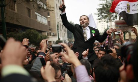 Muslim Brotherhood supporters celebrate outside parliament (Photo: Reuters)