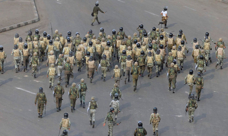Egyptian Army soldiers run at protesters on Tahrir Square