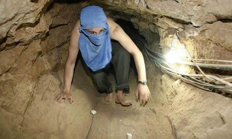 A Palestinian dead with another injured under a collapsed Gaza-Egypt Tunnel