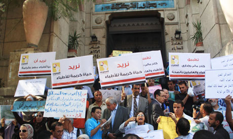 Striking Egyptian doctors stage protest march to demand better healthcare