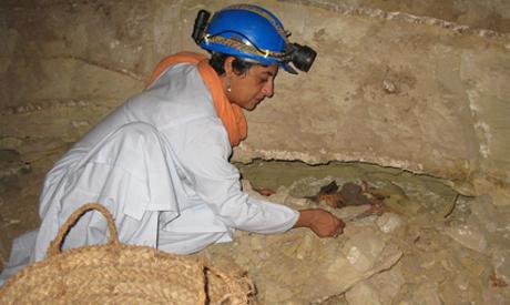 Ikram with a dog mummy. photo courtesy of NG