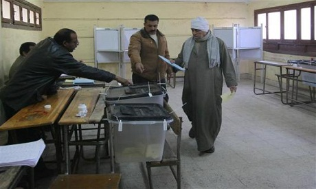 Voter at polling station in the Shura Council elections