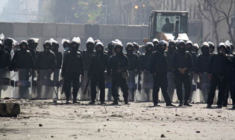 Central Security Forces guard the new wall