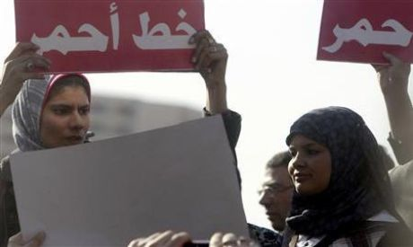 Samira Ibrahim (R) attends a protest against military (Photo by: Reuters
