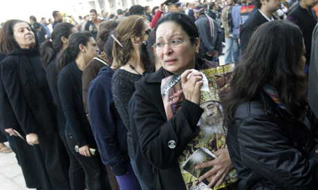 An Egyptian Christian woman carries a poster of the late Pope Shenouda III, the patriarch of the Coptic Orthodox Church outside St. Mark Coptic Orthodox Church in Cairo, Egypt, Tuesday, March 20, 2012. (Photo: AP)