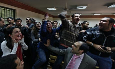 Human rights activists who gathered in support of the NGO Egyptain workers during the trial chant ag