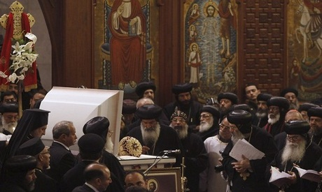 "Egyptian Bishops in front of Pope Shenouda III's coffin in his funeral ""Photo:Reuters"""