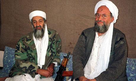 Osama bin Laden sits with Ayman Al-Zawahri
