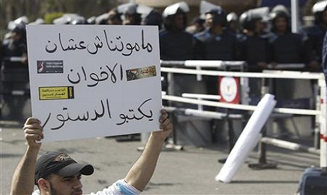 A protester holding a banner against Muslim brotherhood