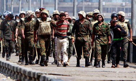 Egyptian army officers arrest a suspected demonstrators
