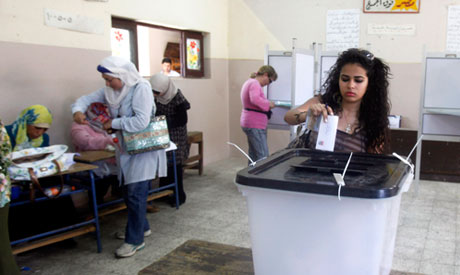 A woman casts her vote at a polling station in Cairo (Reuters)