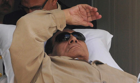 Former Egyptian President Hosni Mubarak is wheeled out of the  courtroom after his trial in Cairo Ju