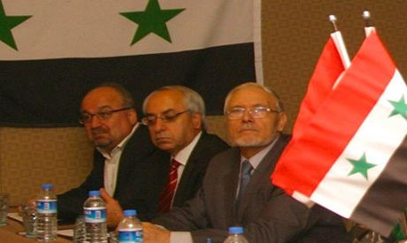 Mohammad Riad Shaqfa (R) seen during a meeting of the Syrian National Council in İstanbul on last ye