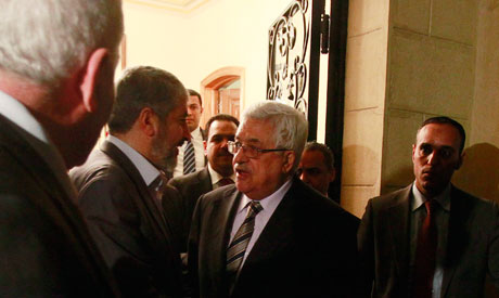 Khaled Meshaal (2nd L) and Mahmoud Abbas