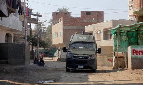 A police vehicle patrols at Dahshour village, about 40 kilometers south of Cairo (Reuters)