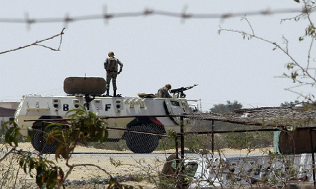 Egyptian soldiers stand guard at a checkpoint in Rafah city on the Egyptian border (Photo by: Reuter