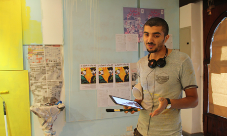 Ganzeer prepares for Virus exhibition in Safarkhan (Photo: Rowan El Shimi)