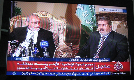 MB supreme guide Mohamed Badie and President Mohamed Morsi