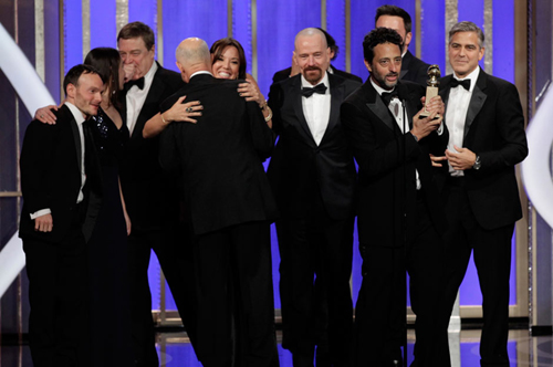 Cast of Argo celebrate win for best drama film. Photo Reuters