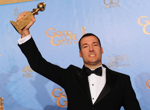 Brave director Mark-Andre with award for best animated feature. Photo: AFP
