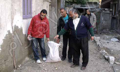 FJP officials on the road after rodents (Photo: Ahram Arabic news website)