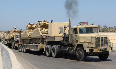 army trucks carrying tanks