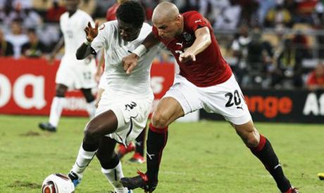 Asamoah Gyan and  Wael Gomaa