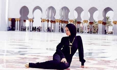 Rihanna sat outside the mosque