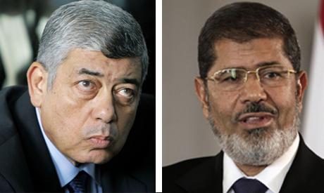 Egyptian Interior Minister Mohammed Ibrahim (L), and ousted Egyptian President Mohammed Morsi