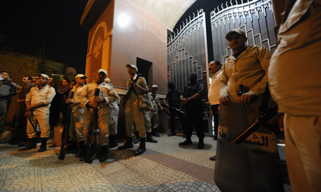 Egyptian security forces stand guard at the Al-Warraq Coptic Christian church