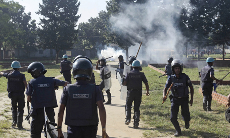 Bangladeshi riot police chase garment workers